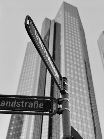 Blackandwhite Germany Frankfurt Iphonephotography Communication Text Low Angle View Guidance Architecture Building Exterior Built Structure City Skyscraper No People Close-up Road Sign Day Outdoors Sky