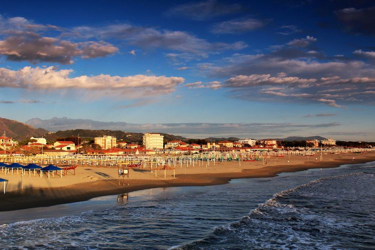 Marina di Pietrasanta Travel Architecture Beach Beauty In Nature Blue Building Exterior Built Structure City Cityscape Cloud - Sky Day Mountain Nature No People Outdoors Sea Sky Town Travel Destinations Vacation Water