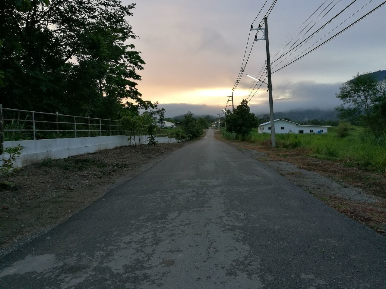 diminishing perspective, the way forward, sky, road, tree, cable, transportation, no people, electricity pylon, cloud - sky, outdoors, sunset, nature, day, telephone line