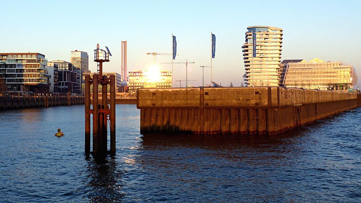 Waterfront Water Built Structure Architecture Rippled River Building Exterior Wooden Post City Pole Sea Development Urban Skyline Modern Tranquility Tall Tall - High Hafencity Hamburg New District Harbour City Sunset Elbe River Golden Light Full Colors Of Autumn Romaticsunset