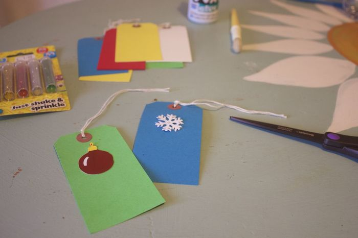 making christmas present tags Christmas Crafts Holiday Gifting Art And Craft Close-up Communication Container Craft Creativity Education Emotion Focus On Foreground Heart Shape High Angle View Indoors  Message Multi Colored No People Paper Positive Emotion Still Life Table Text Western Script