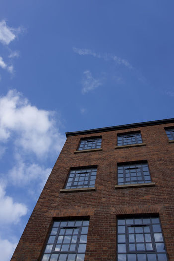 Northern Quarter building detail in Manchester, UK Manchester Day Architecture No People Built Structure Sky Low Angle View Cloud - Sky Building Exterior Window Building Nature Blue Outdoors Sunlight City Brick Residential District Copy Space Wall Brick Wall