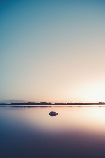 Memories of Summer. Sunset Reflection Tranquility Sky Tranquil Scene Scenics Beauty In Nature Water Nature Copy Space Sea Beach Clear Sky Horizon Over Water Dusk Sunlight Outdoors Blue No People Waterfront Beauty In Nature Backgrounds Pentax Sweden Nature