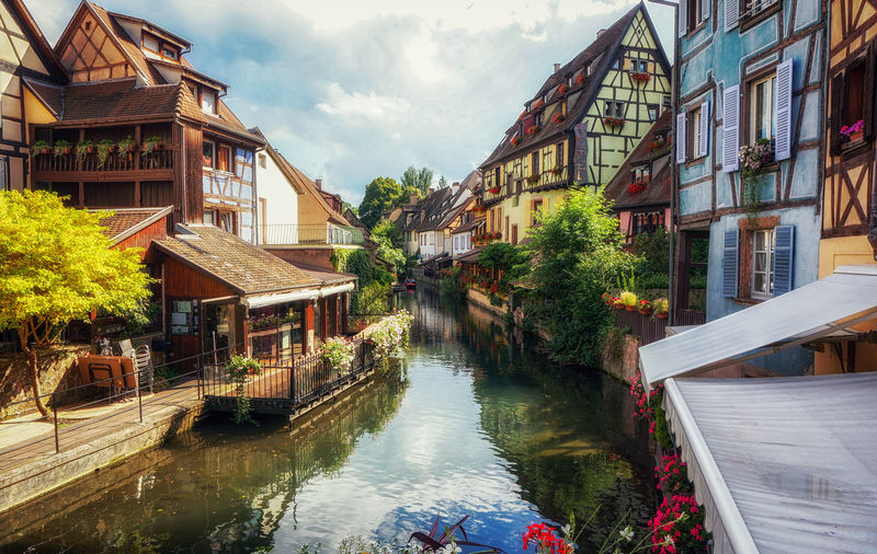 little venice colorful canal view in colmar alsace region of france. Alsace Architecture Building Exterior Built Structure Canal Canal Walks Colmar Colmar, Alsace, France Day European Village France French Growth House Little Venice No People Outdoors Residential Structure Sky Travel Village Village View Water Waterfront Waterway