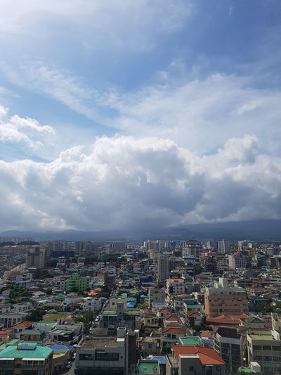 city under clouds Clouds And Sky EyeEm Gallery Summertime JEJU ISLAND  City Cityscape Urban Skyline Skyscraper Downtown District Aerial View Residential Building High Angle View Sky
