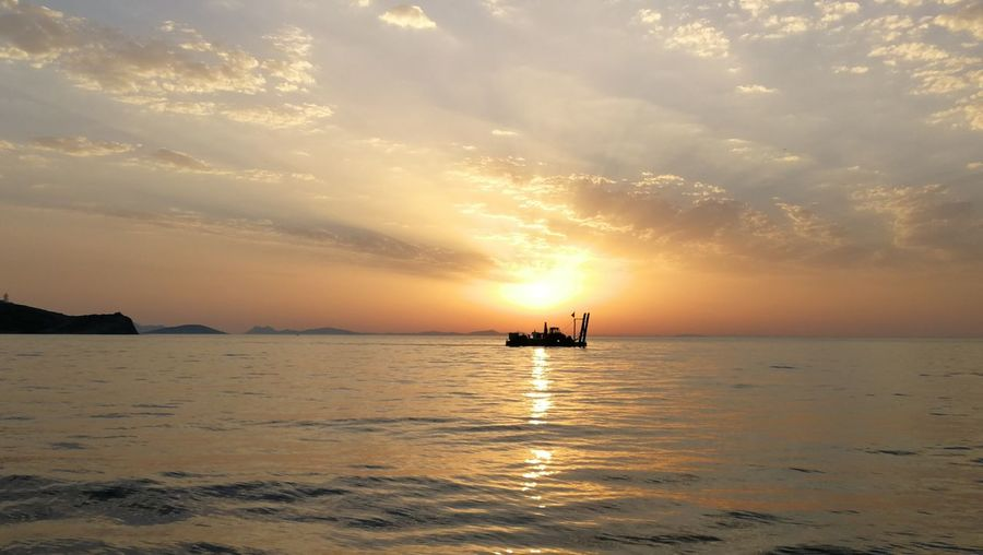 EyeEm Selects Water Nautical Vessel Sea Sunset Beach Silhouette Gold Colored Sun Oil Pump Reflection