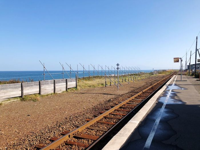 Sky Clear Sky Nature Sea Day Copy Space Water Rail Transportation Track Railroad Track Beach No People Sunlight Blue Direction Outdoors Transportation