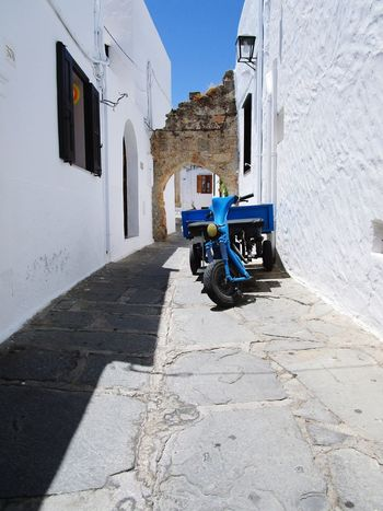 The ride Sunshine Bright Day Greece Lindos Shadow Sunlight Architecture Building Exterior Built Structure Scooter Motor Scooter