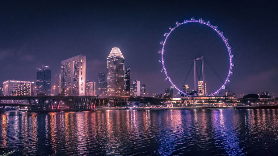 Singapore night lights Amusement Park Amusement Park Ride Architecture Building Building Exterior Built Structure City Cityscape Ferris Wheel Financial District  Illuminated Nature Night Nightlife No People Office Building Exterior Outdoors Reflection River Sky Skyscraper Travel Destinations Water The Still Life Photographer - 2018 EyeEm Awards
