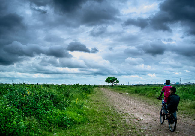 Long way to go Bangladesh Before Raining Cloud - Sky Cloudscape Community Outreach Cycling Day Dhaka Grass Natural Beauty Nature One Person Only Men Outdoors People Sky Storm Cloud Thunderstorm Weather Weather Young Adult
