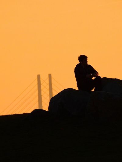 Silhouette Sunset Man March 2017 Rocks Sitting Sitting Outside View Scenic Dusk Leisure Activity One Person Real People One Man Only Outdoors Lifestyles