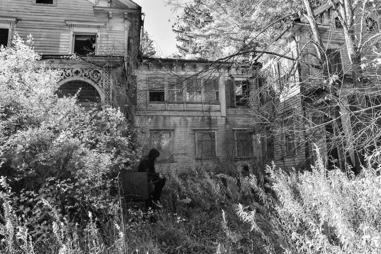 Low section of person standing by old building