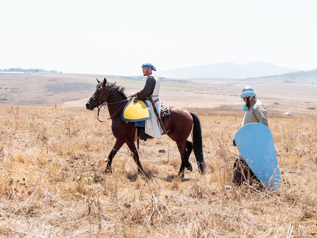 Tiberias, Israel, July 01, 2017 : Participants in the reconstruction of Horns of Hattin battle in 1187 moving around the battlefield near Tiberias, Israel Army Battle Cross Crusaders Field Guy De Lusignan Hattin Heat Heritage History Horn Horseman Infantry Israel Jerusalem KINGDOM Muslims Palestine Reconstruction Religion Saladin Templars Victory War Weapons