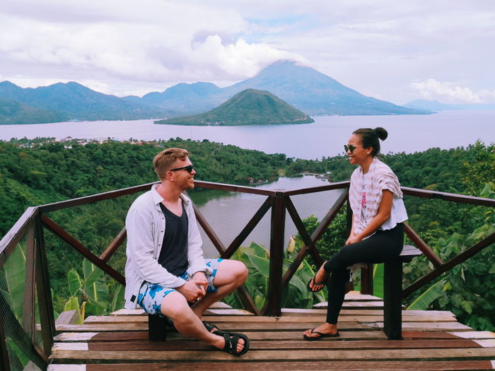INDONESIA Ternate Island, Molucca Tidore Island, Molucca Mature Couple Full Length Men Togetherness Bonding Sitting Women Happiness Couple - Relationship Smiling Couple Lakeside Leisure