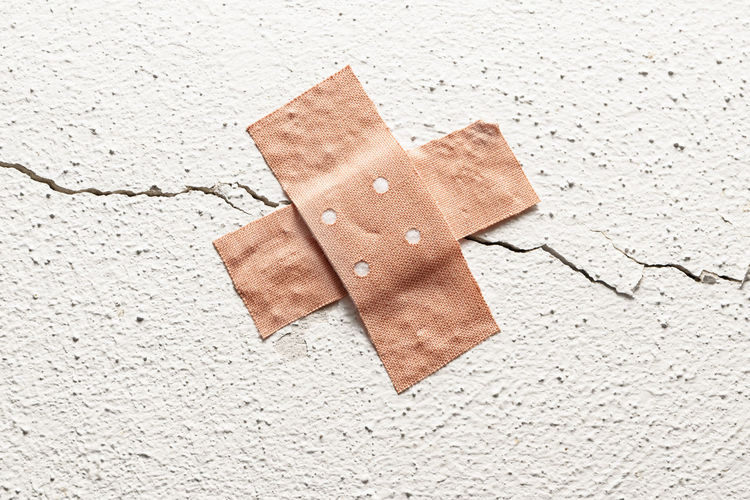Care Copy Space Medicine Objects Renovation Wall Band Aid Botched Bungle Concept Constuction Crack Health Health Care Medical Metaphor Object Plaster Protection Recovery Symptom Textured  White Wound
