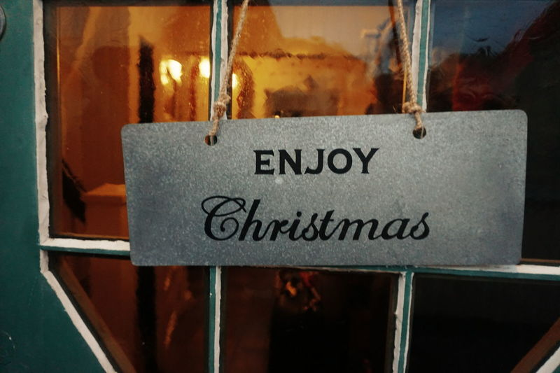 enjoy christmas Text Communication Close-up No People Outdoors Day Entrance Home For Christmas Christmas Decoration Christmas Christmas Lights Celebration Festive Door Doors Doorway Sign Enjoy Christmas Welcome Homecoming