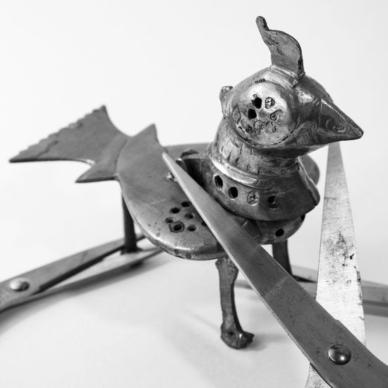 A brass bird figurine being cut with scissors from different angles. Budget Emotions Fear Loan  Pawn Shop Abus Addiction Animal Representation Close-up Concept Conceptual Cost Effective Costs Danger Dead End Debt Expenses Indoors  Money Lending No People EyeEmNewHere