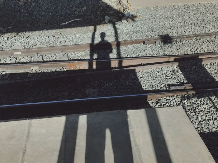 High angle view of person standing on railroad track