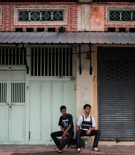 Resting Old Town Tired Weak Architecture Two People Building Exterior Built Structure Men City Adult Real People Building Sitting Young Adult Couple - Relationship Togetherness