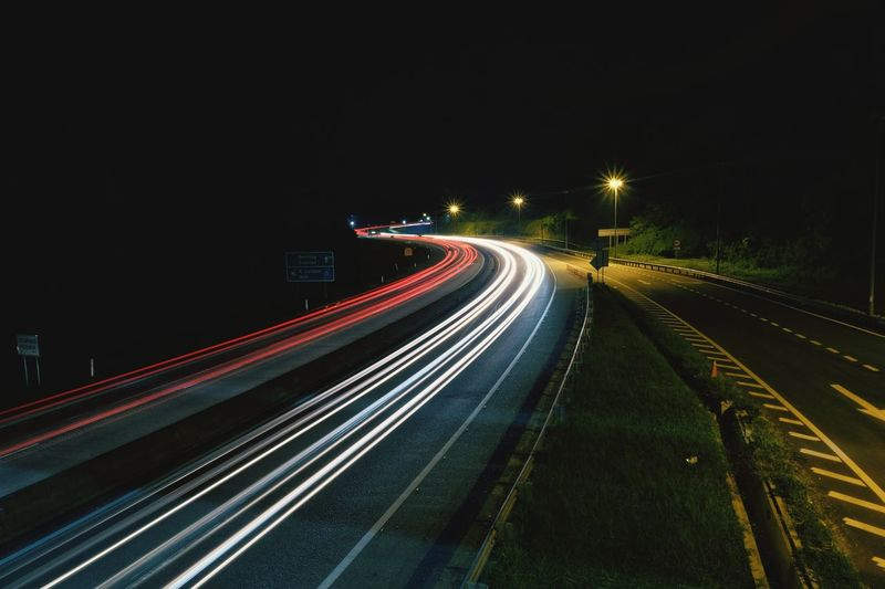 HIGHWAY LIGHT TRAIL Illuminated City Motion Rush Hour Long Exposure Speed Light Trail Road Blurred Motion Traffic Moving Highway Two Lane Highway Headlight Multiple Lane Highway Car Point Of View High Street Longtail Boat Viaduct Dividing Line Road Intersection Wake - Water Windshield Road Marking Urban Scene Street Light Crossroad Zebra Crossing Thoroughfare Wake