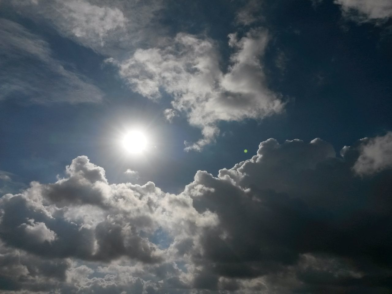 beauty in nature, nature, sun, sunbeam, sky, cloud - sky, tranquility, low angle view, scenics, sunlight, outdoors, no people, sky only, tranquil scene, day