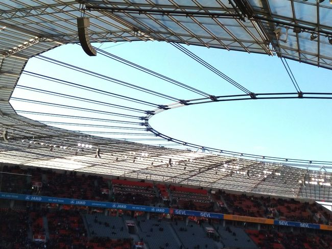 sports arena stadium and clear blue sky Stadion Stadium Soccer Arena Soccer Arena Sports Arena Clear Sky Blue Sky Roof Steel Construction Glas Transparent Bundesliga Indoors  No People Day Architecture Sky