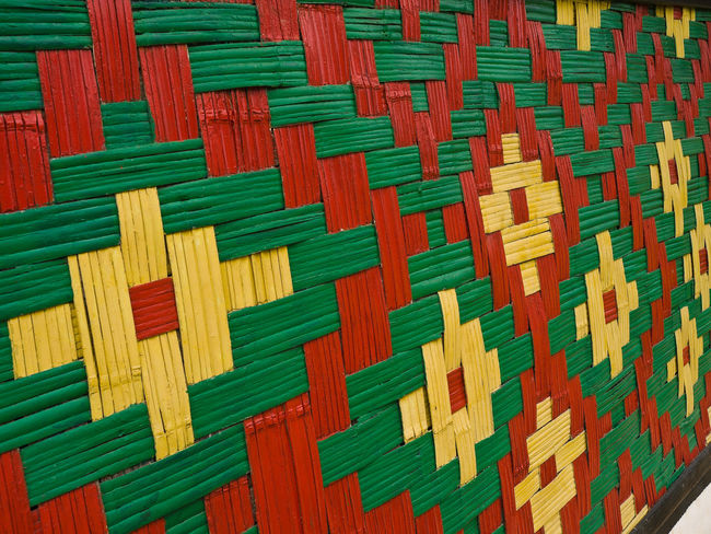 Woven Walls of Chiefs meeting hut ,Vanuatu is a Pacific island nation located in the South Pacific Ocean. The archipelago, which is of volcanic origin, is some 1,750 kilometres (1,090 mi) east of northern Australia, 540 kilometres (340 mi) northeast of New Caledonia, east of New Guinea, southeast of the Solomon Islands, and west of Fiji. Vanuatu was first inhabited by Melanesian people. The first Europeans to visit the islands were a Spanish expedition led by Portuguese navigator Fernandes de Queirós, who arrived on the largest island in 1606. As the Portuguese and Spanish monarchies had been unified under the king of Spain in 1580 (following the vacancy of the Portuguese throne, which lasted for sixty years, until 1640, when the Portuguese monarchy was restored), Queirós claimed the archipelago for Spain, as part of the colonial Spanish East Indies, and named it La Austrialia del Espíritu Santo. In the 1880s, France and the United Kingdom claimed parts of the archipelago, and in 1906 they agreed on a framework for jointly managing the archipelago as the New Hebrides through a British–French Condominium. An independence movement arose in the 1970s, and the Republic of Vanuatu was founded in 1980. Backgrounds Banks Islands Close-up Dance Day Epi Island Full Frame Futuna Island, Vanuatu Indoors  Large Group Of Objects Melanesia Melanesian Multi Colored No People Pacific Ocean Palm Tree Pattern Red Tourism Tourist Attraction  Travel Travel Destinations Tribal Village Vivid International