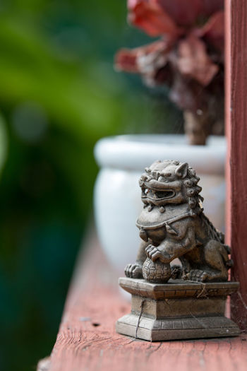 Asian Guardian Lion Asian  Asian Culture Green Greenery Scenery Guardian Lion Lion Asian Garden Asian Garden Pie Chinese Culture Close-up Focus On Foreground Garden Greenery Guardian Lions No People Outdoors Religion Sculpture Spirituality Statue Spider Web Spiderweb