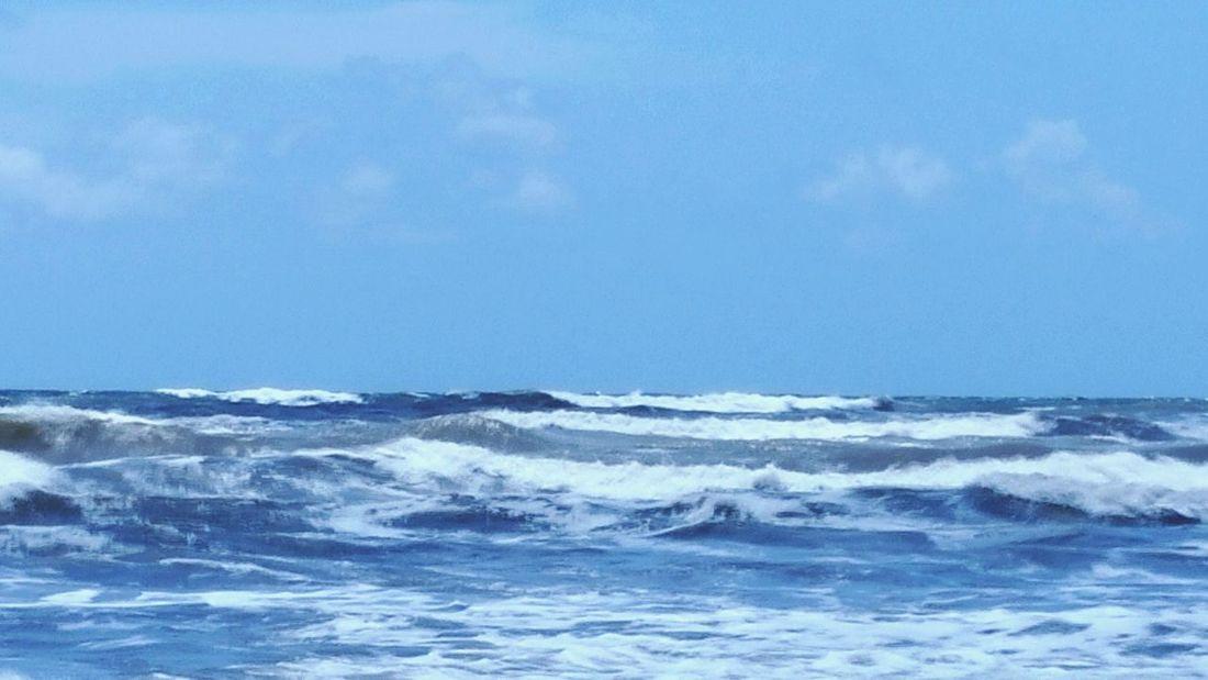 Surf On The Beach Enjoying The Sun Sea