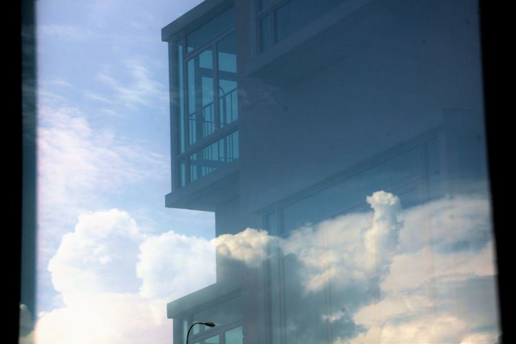 The pic of a building reflected in glass against cloud background A Room In The Clouds Building Exterior Built Structure Cloud Cloud - Sky Cloud Photography High Section Reflection In Glass Residential Building