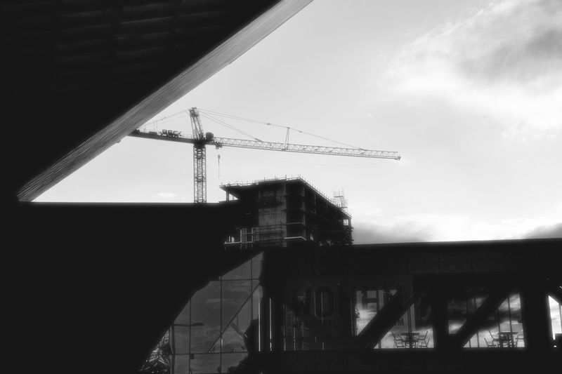 Low angle view of silhouette built structure against sky