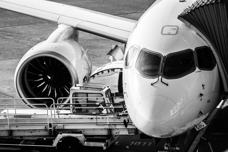 Business Service Ramp Gate Mode Of Transportation Airplane Air Vehicle Transportation Airport Day No People Travel Public Transportation Engine Airport Runway Land Vehicle Nature Metal Aerospace Industry Stationary Close-up Commercial Airplane Jet Engine