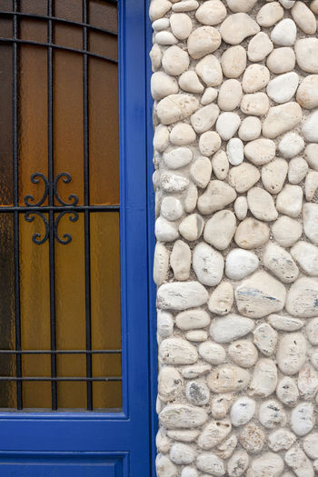 Old door with wall facade made with sea rounded stones in a mediterranean style Architecture Mediterranean  Mediterranean Architecture Architectural Detail Architecture Backgrounds Built Structure Door Facades Outdoors Pebble Stones Stones