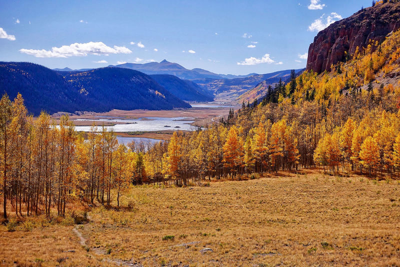 A landscape in the San Juan National Forest in the USA. Autumn Colors Colorado San Juan Trees Beauty In Nature Clouds Day Forest Lakeshore Landscape Meadow Mountain Range Mountains Nature No People Outdoors Scenics Sky Tranquil Scene Tranquility