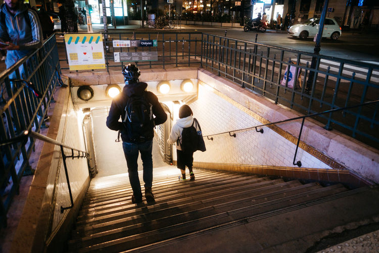 High angle view of people walking on illuminated street at night