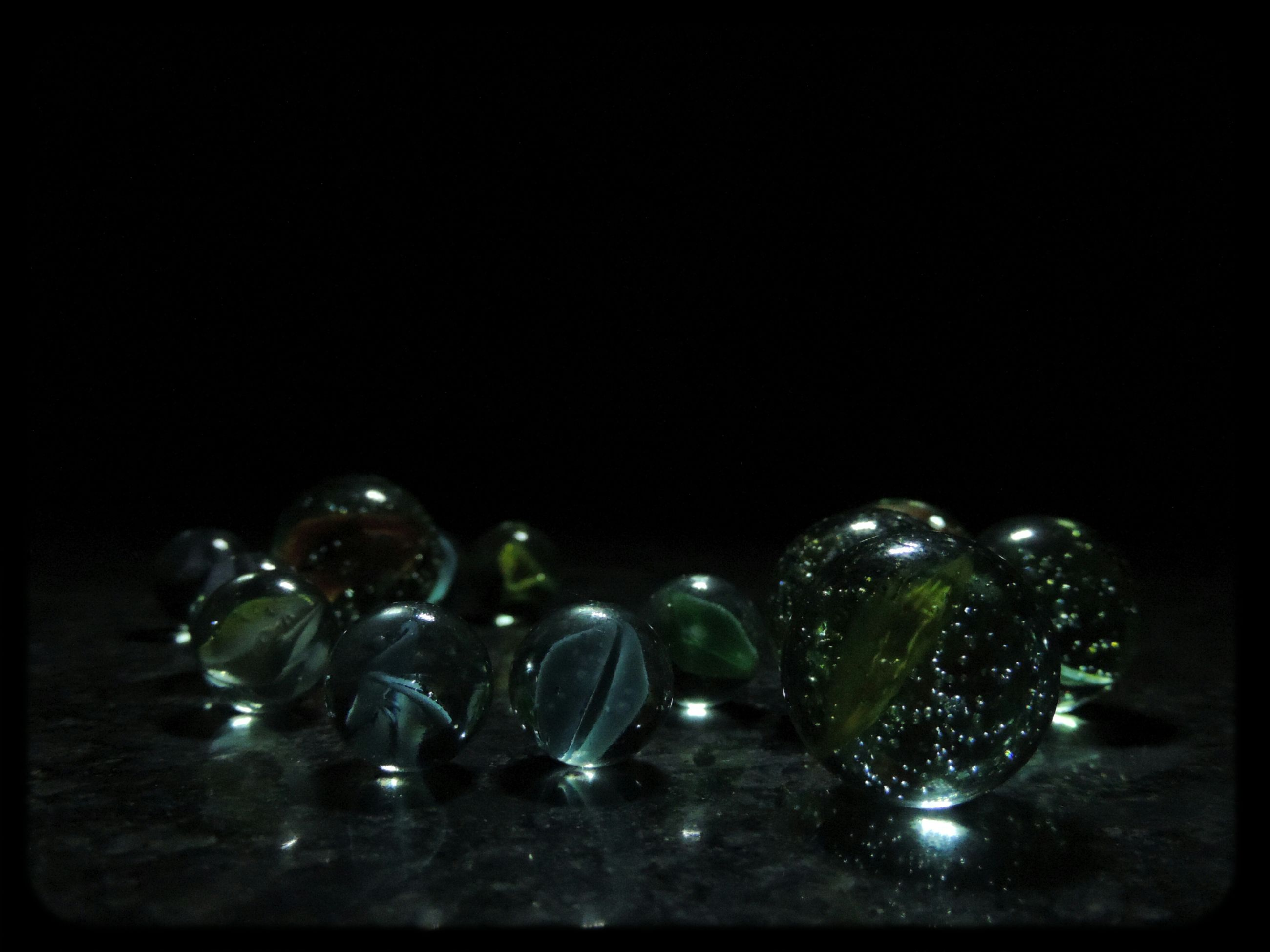 studio shot, still life, indoors, black background, close-up, table, large group of objects, copy space, glass - material, water, variation, no people, reflection, arrangement, transparent, high angle view, bottle, white background, drop, group of objects
