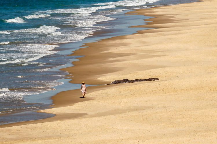High angle view of woman walking on beach