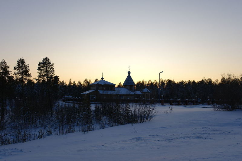 Siberian wooden church after blizzard Architecture Cold Temperature Nature Scenics - Nature Sky Snow Sunset Tree Winter