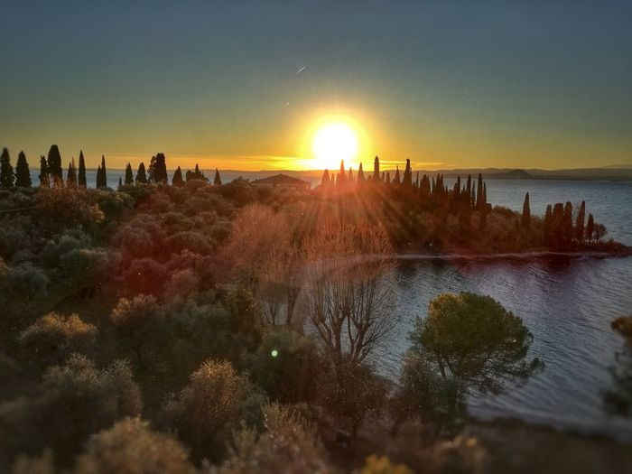 Italy Lake Garda Lake Plant Love Nature Nature Photography EyeEmNewHere Beautiful Lake Front Sun Lagoon Water Punta San Vigilio Baia Delle Sirene Sunlight Sea Landscape Horizon Over Water Tranquil Scene Orange Color Tranquility Coast