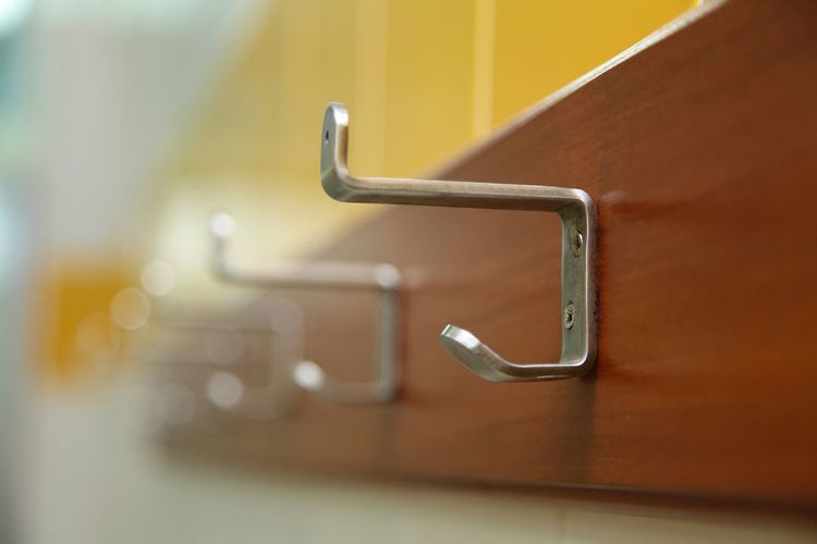Close-Up Of Hooks In Bathroom