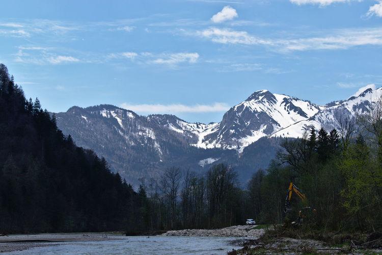 Breitenstein and Aache river. Excavator Breitenstein Aache River Alps Tree Mountain Snow Snowcapped Mountain Water Forest Sky