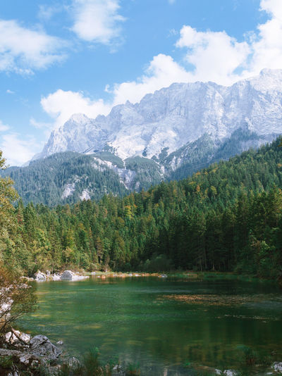 Scenic shot of calm lake against mountain range
