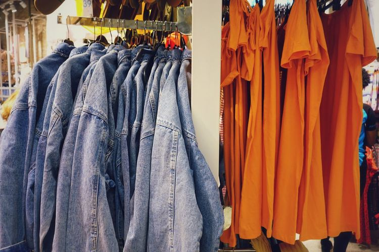 Clothes Hanger Casual Clothing Casual Jacket Jeans T-shirt Tshirts Orange Color Springtime Spring Blue Denim Young Bright Colors Madrid Retail  Textile Store Variation Fashion Choice Business Finance And Industry Cloth For Sale Fabric Stall Market Stall Clothes Clothes Rack Clothesline