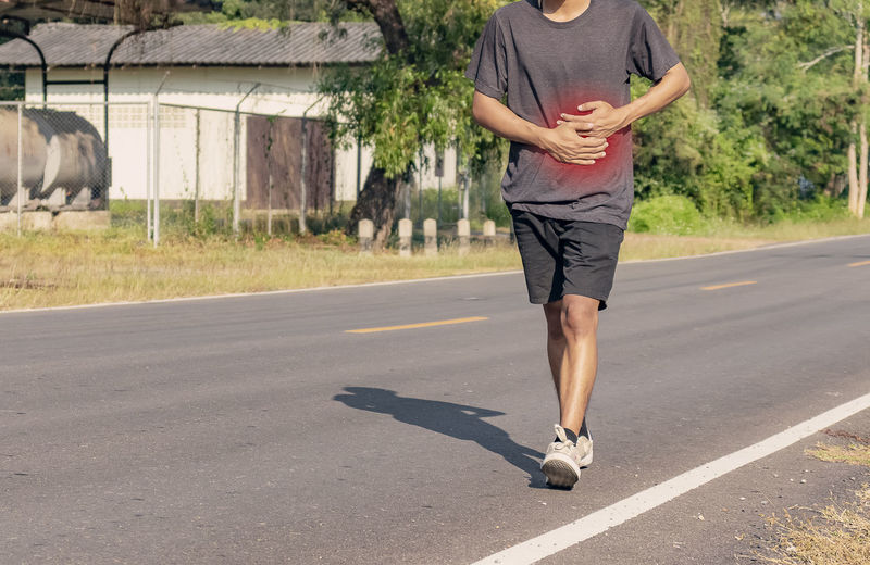 Full length of man skateboarding on road