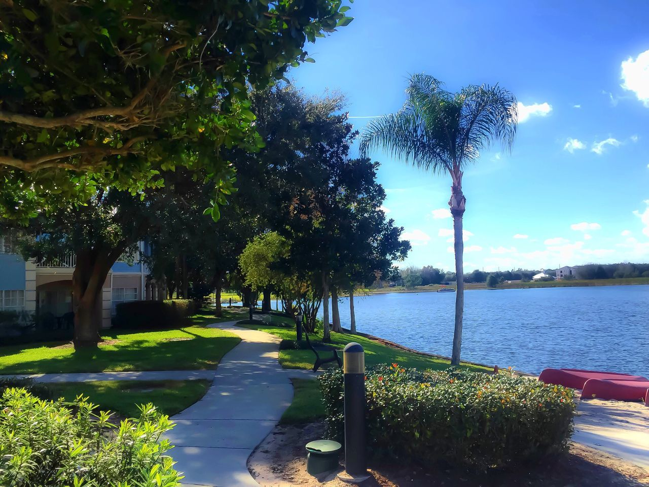 View of pathway by calm lake
