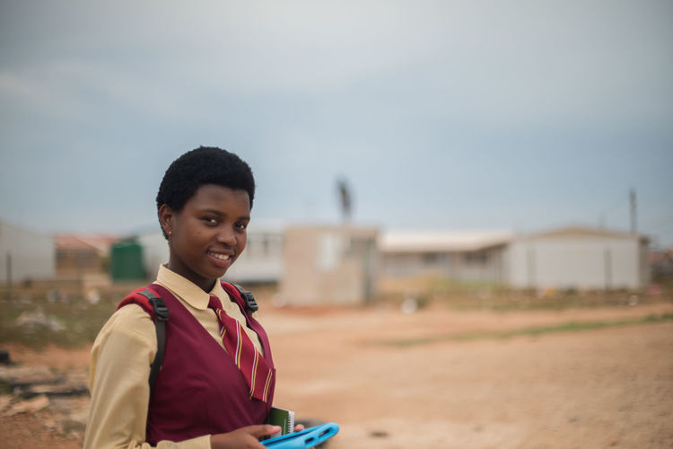 enroute to school Tablet Built Structure Day Focus On Foreground Lifestyles Looking At Camera One Person Outdoors People Portrait Real People School Kid School Uniform Sky Smiling Technology Young Women