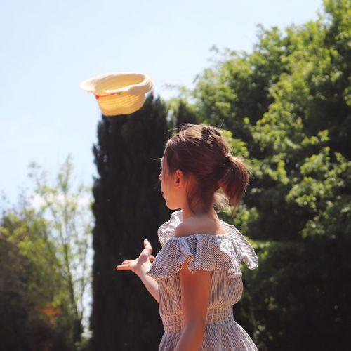 Cute girl standing against trees