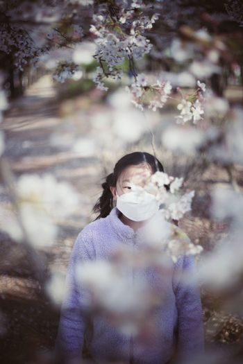 High angle view of girl wearing mask standing in park