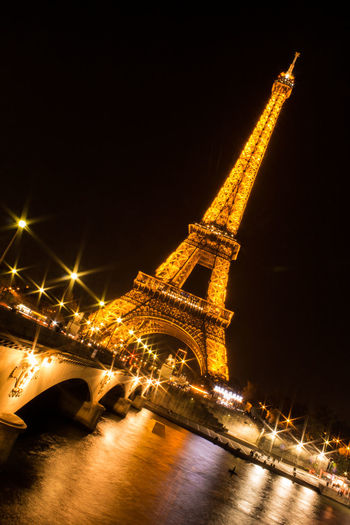 Architecture Bridge - Man Made Structure Building Exterior Built Structure City Cityscape Cultures Eiffel Tower Gold Colored Illuminated Low Angle View Night Nightphotography No People Outdoors Paris Sky Star - Space Statue Tour Eiffel Tourism Travel Travel Destinations Traveling Home For The Holidays