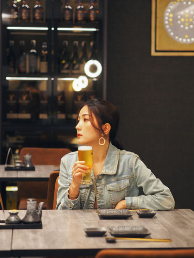Young woman drinking glasses on table at cafe